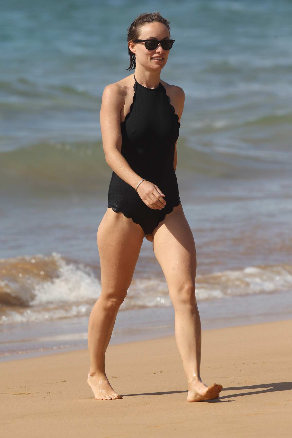 Olivia Wilde in a black swimsuit enjoying the ocean during her extended thanksgiving vacation in Hawaii