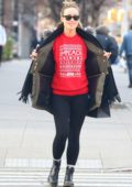 Olivia Wilde spotted wearing a red 'IMPEACH' Christmas sweater while shopping in Soho, New York City