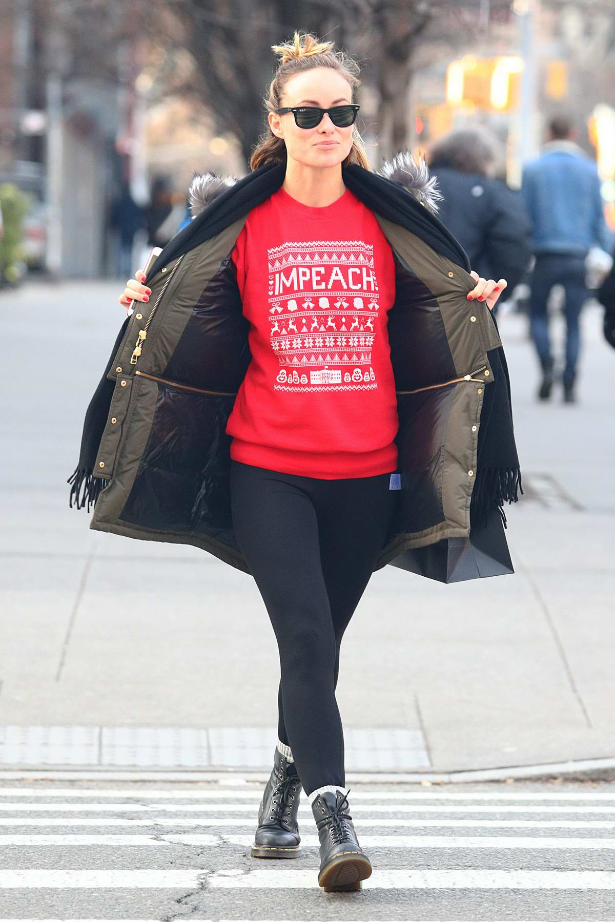 olivia wilde spotted wearing a red 'impeach' christmas ...
