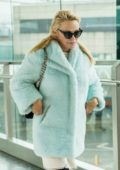 Pamela Anderson looked very tired as leaves Heathrow airport in London