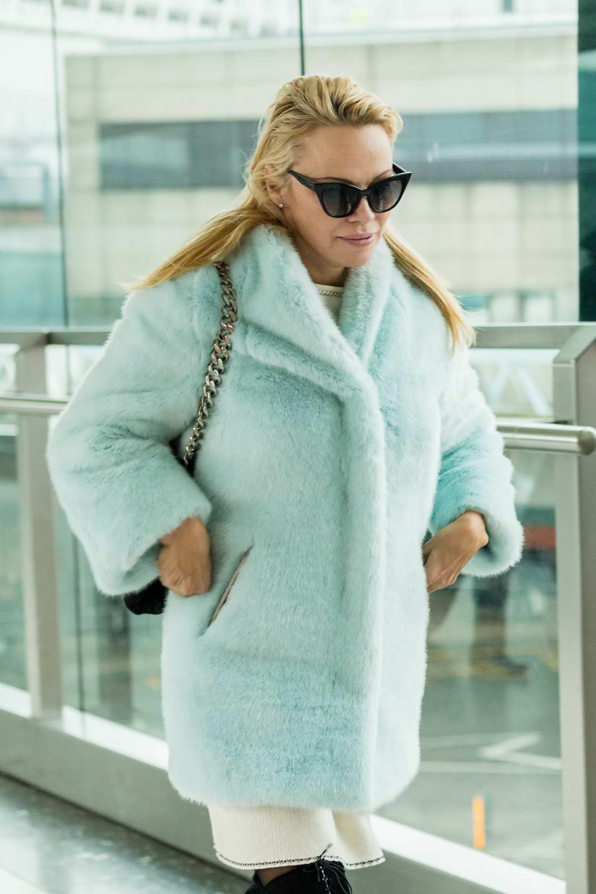 Pamela Anderson looked very tired as leaves Heathrow airport in London