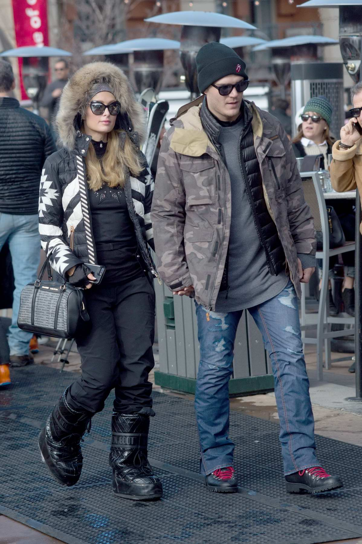 Paris Hilton and boyfriend Chris Zylka hold hands as they head to go skiing in Aspen, Colorado
