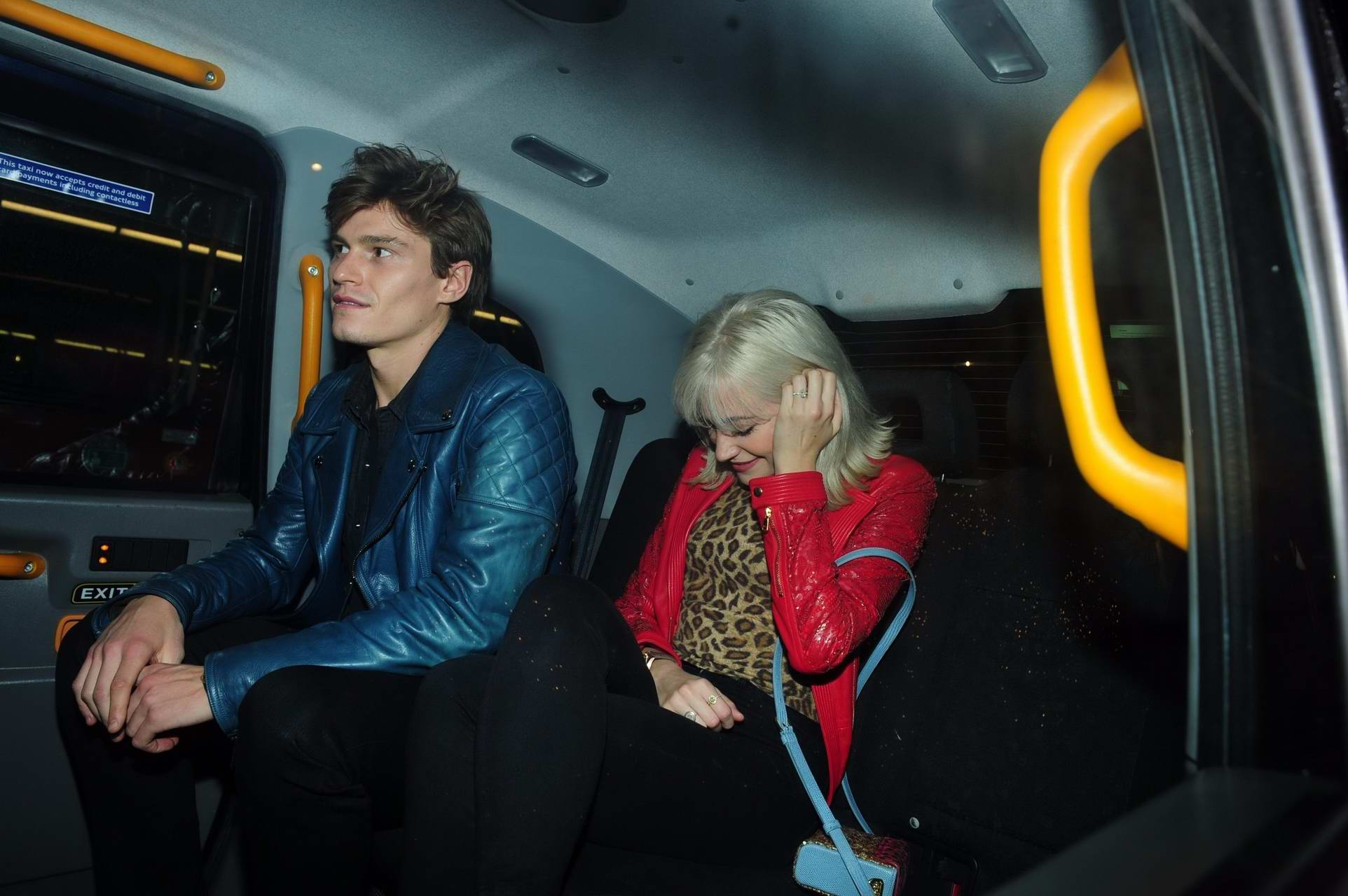 Pixie Lott on a night out with her fiance Oliver Cheshire in London