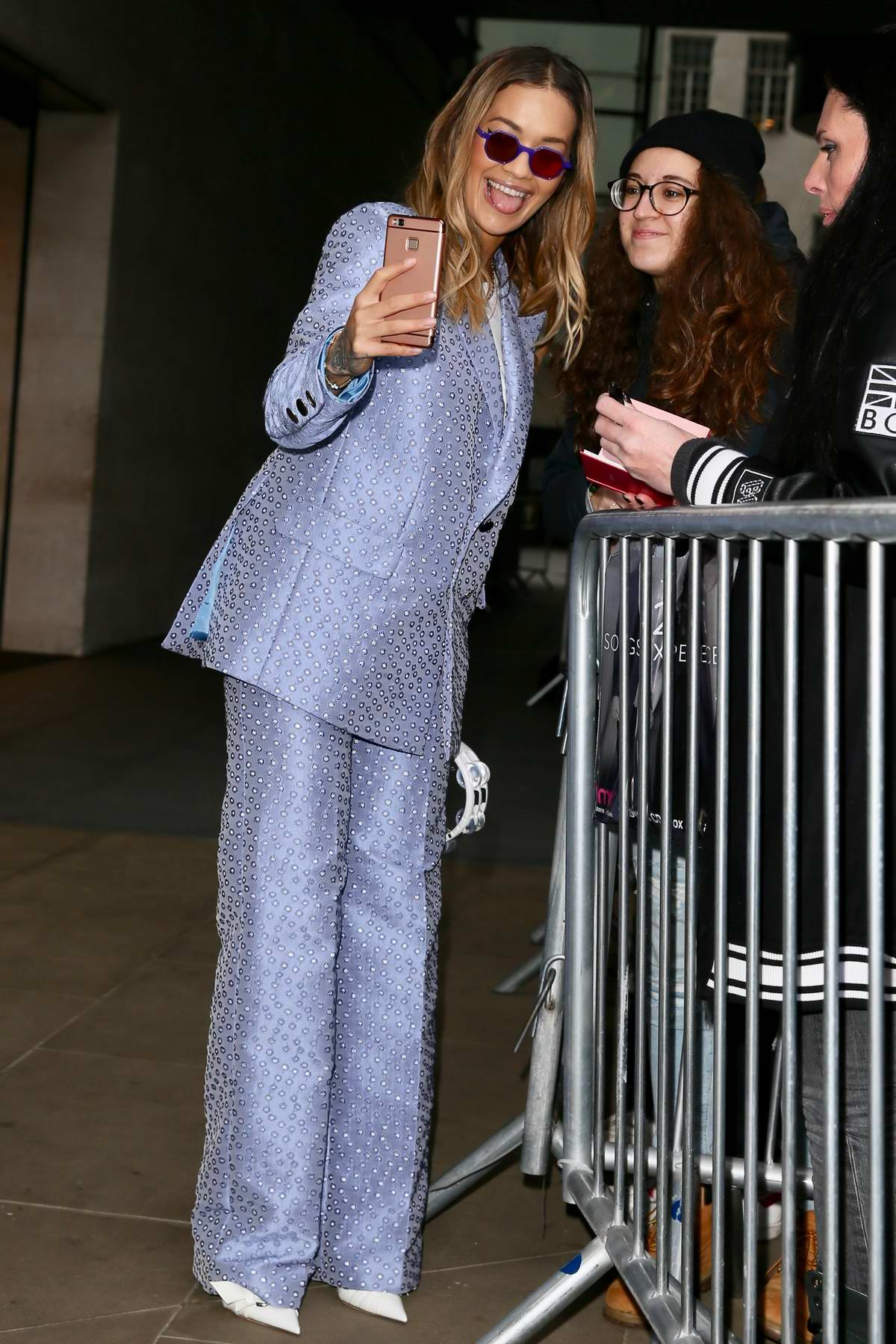 Rita Ora in a blue suit leaving BBC Radio One studios after appearing on the show in London