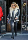 Rita Ora wore a shearling jacket as leaving her hotel in New York City