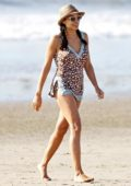 Rosario Dawson in a cute bathing suit on the beach in Los Angeles