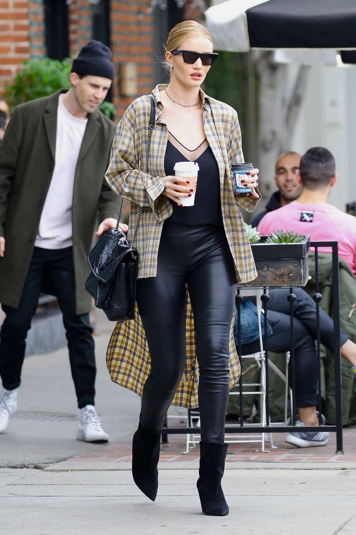 Jason Statham and Rosie Huntington-Whiteley take a walk