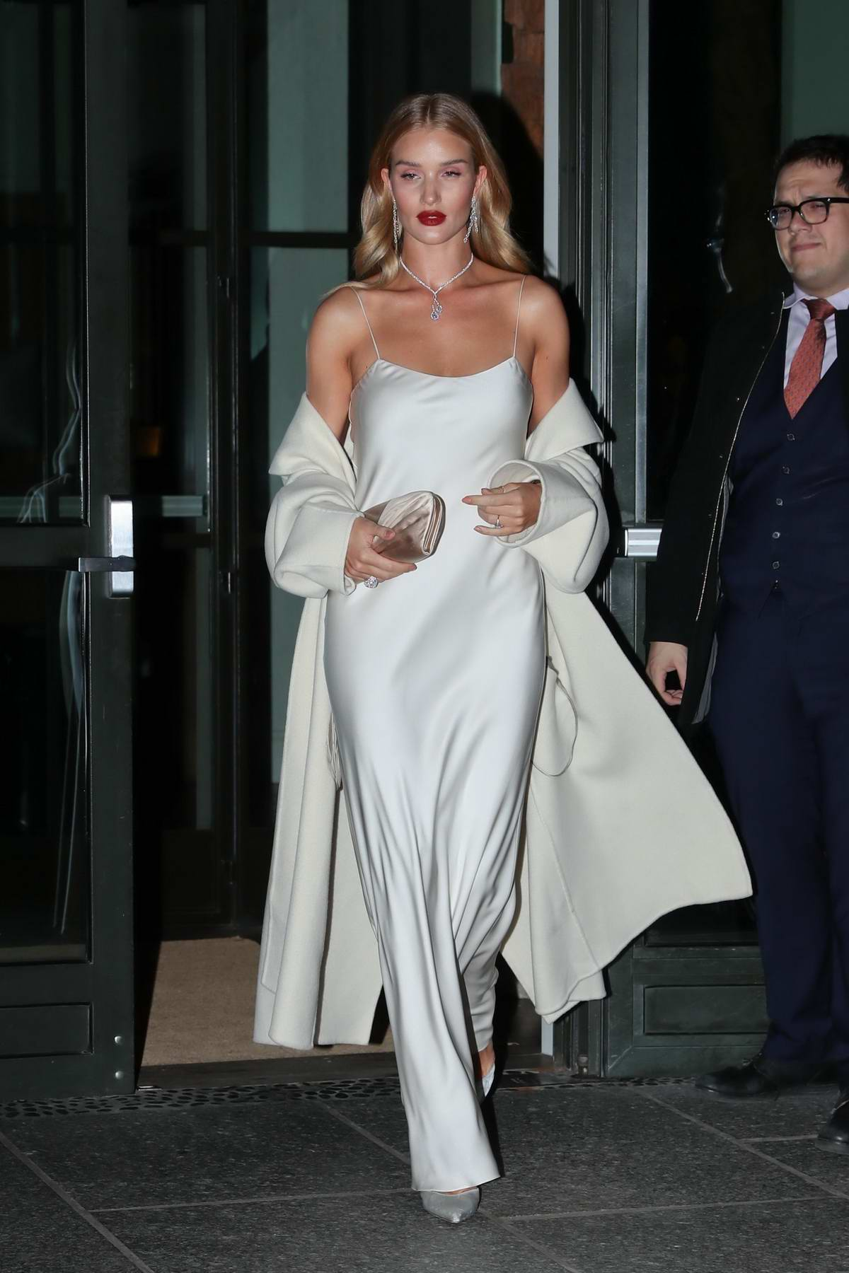 Rosie Huntington Whiteley Looks Stunning In A White Gown As Leaves