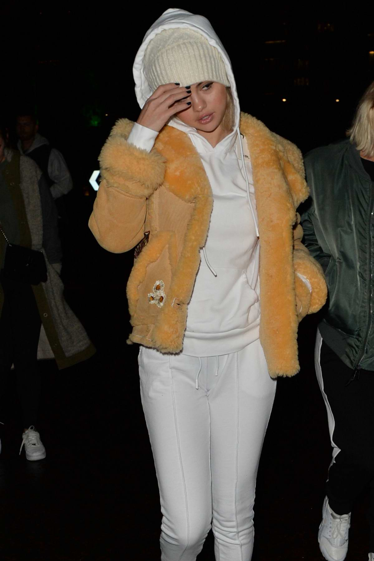 Selena Gomez dressed for cold in a fur jacket and hoodie while out in London