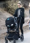 Selena Gomez walks her friend's baby in stroller as they go hiking in Los Angeles
