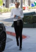 Sofia Richie wearing a white long sleeve top and black jeans stops by Tom Ford in Beverly Hills, Los Angeles