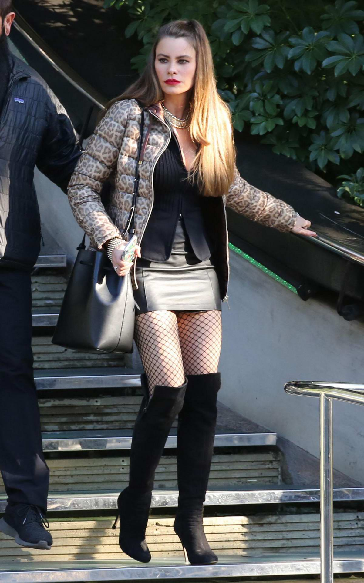 Sofia Vergara dressed in a mini skirt paired with high knee boots filming a scene on the set of 'Modern Family' in Los Angeles
