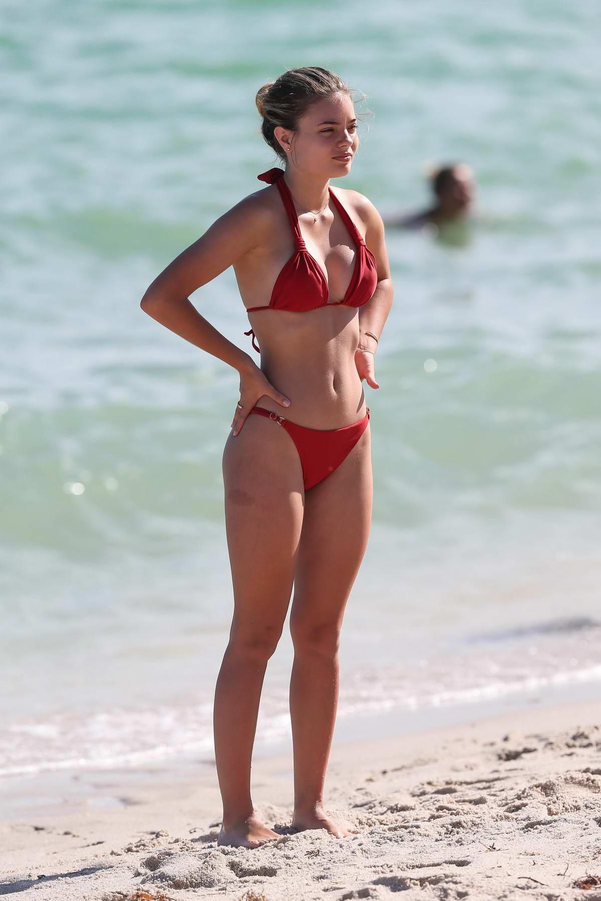 Sophia Vantuno in a red bikini enjoying the ocean in Miami, Florida