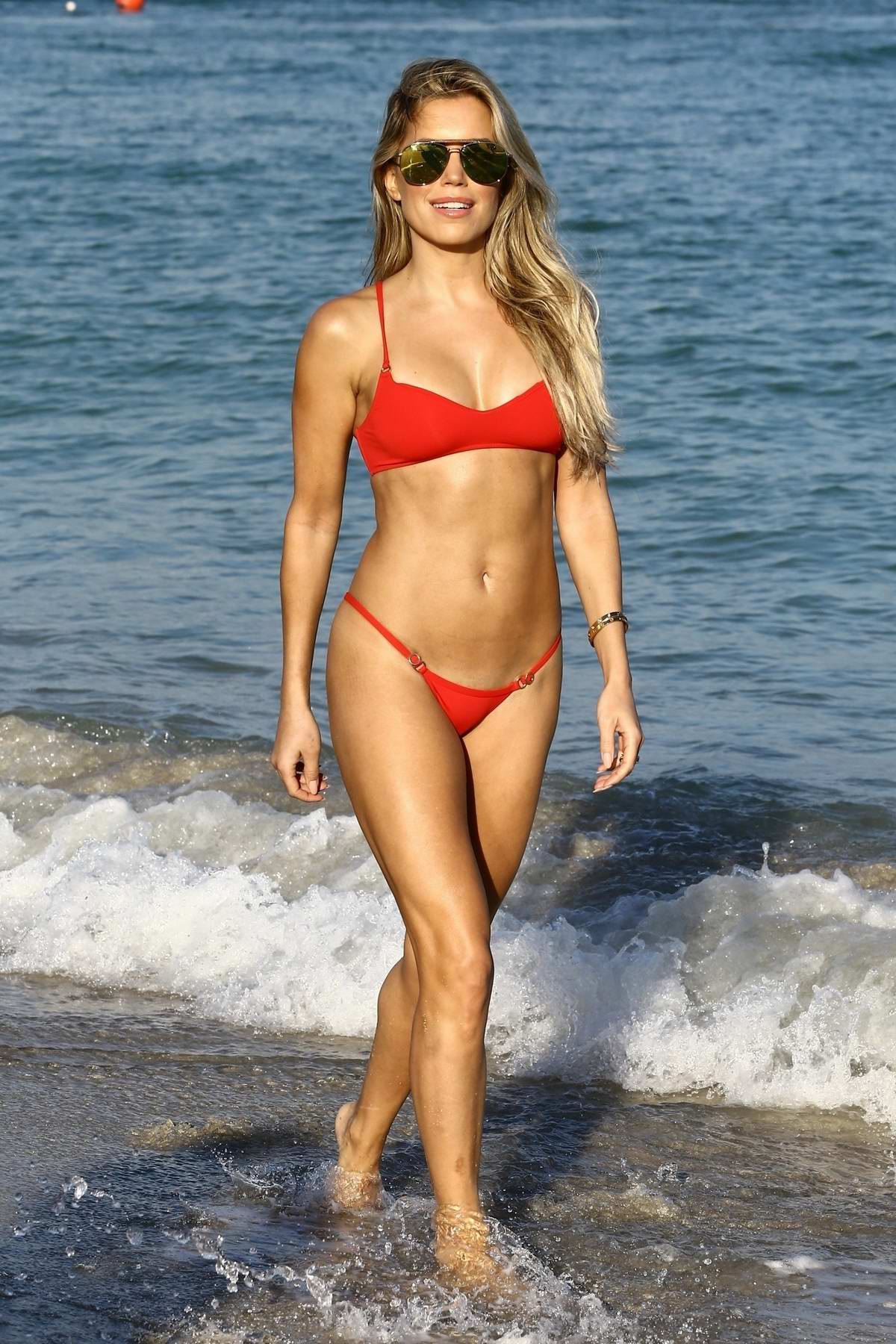 Sylvie Meis spends another day at the beach wearing a red bikini in Miami, Florida