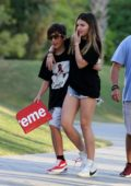Thylane Blondeau wears a black t-shirt and denim shorts as she hangs out with friends in Miami, Florida