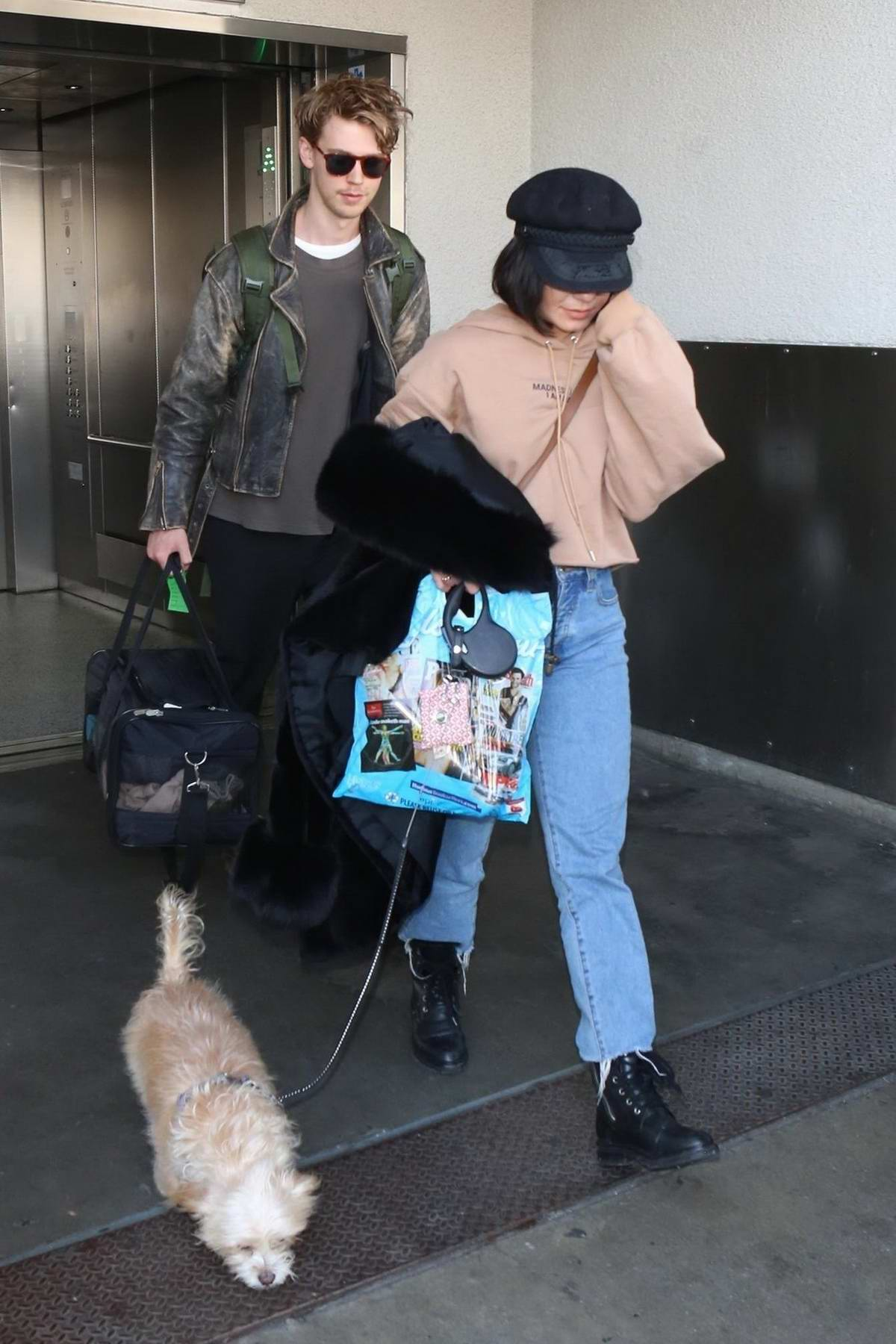 Vanessa Hudgens and boyfriend Austin Butler arrive at LAX with her dog