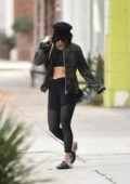 Vanessa Hudgens dressed in all black workout gear leaves Pilates in Los Angeles