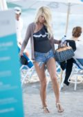 Victoria Silvstedt and boyfriend Maurice Dabbah enjoy a day on the beach in Miami, Florida