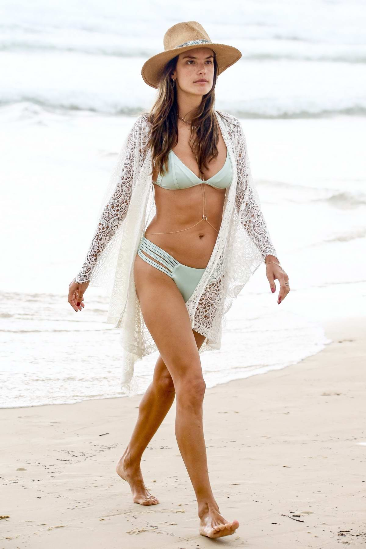 Alessandra Ambrosio dons a pastel teal bikini as she spends another at the Praia Brava beach in Florianoplis, Brazil
