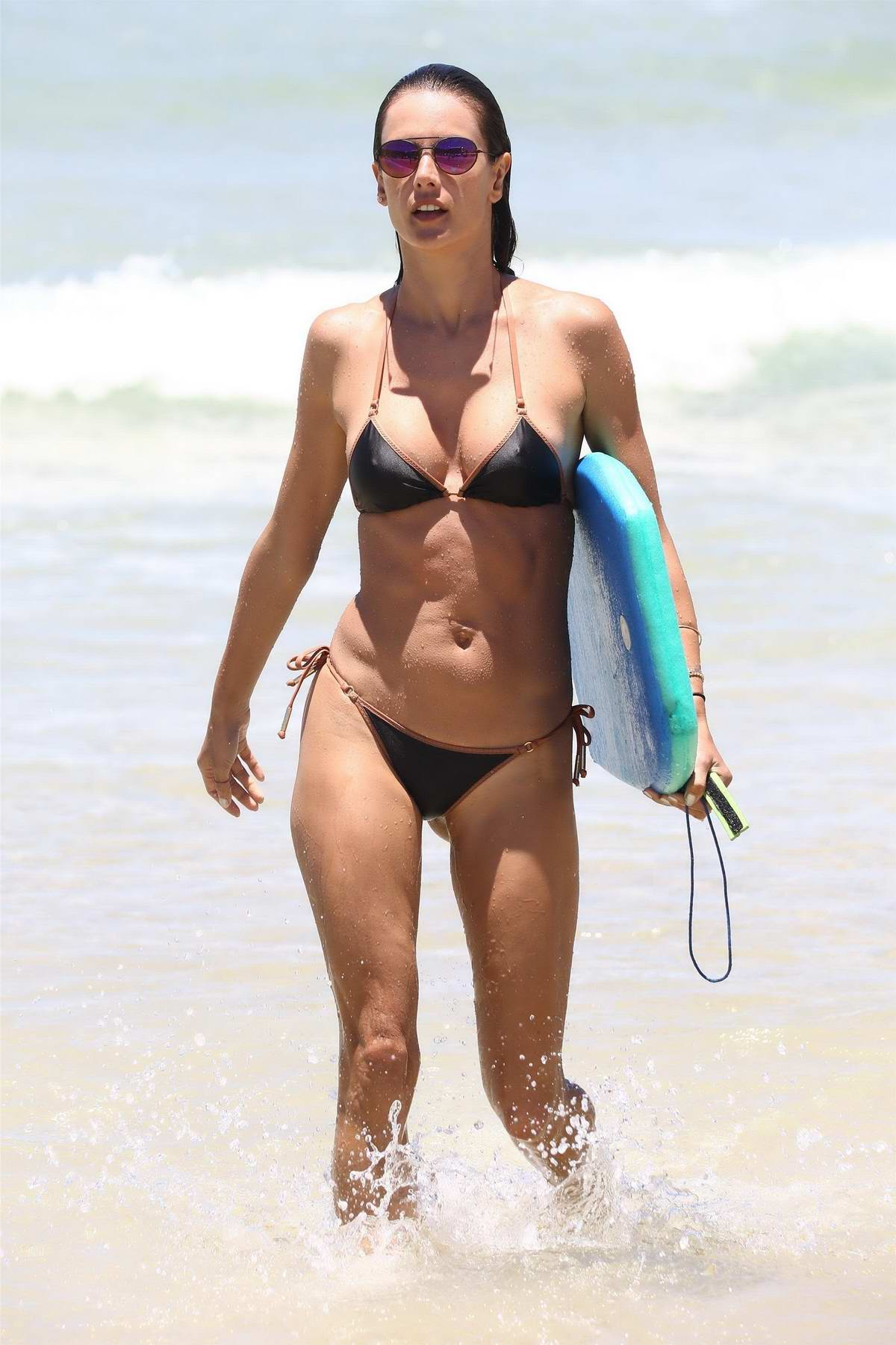 Alessandra Ambrosio hits the beach one more time looking perfect in a black bikini in Brazil