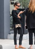 Alicia Vikander dressed in casual black, grabs lunch with a friend in Beverly Hills, Los Angeles