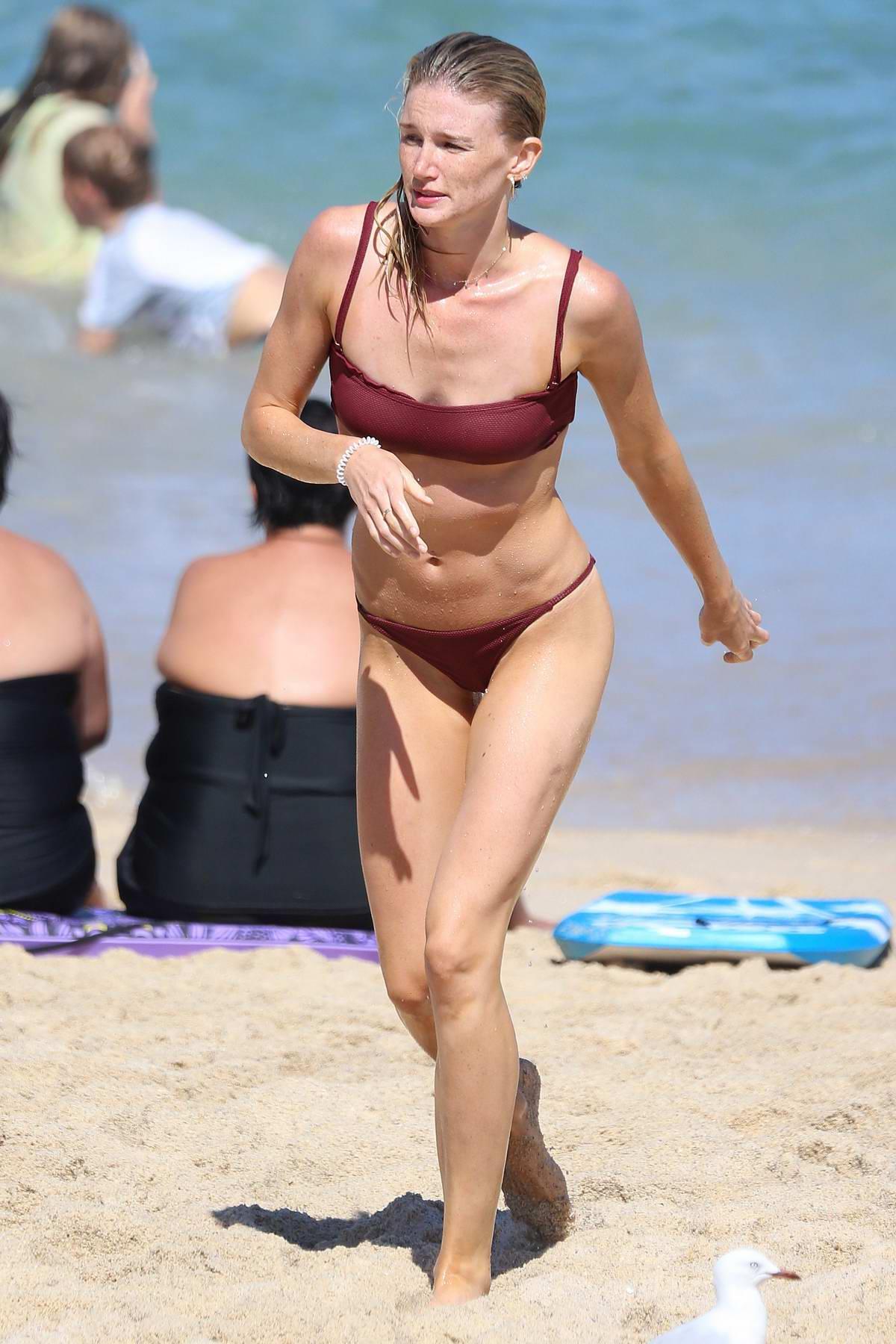 Amy Pejkovic rocks a bikini as she goes for a swim at Bronte beach in Sydney, Australia