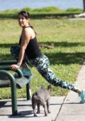 Andrea Calle gets some workout with her bulldog at a park in Los Angeles