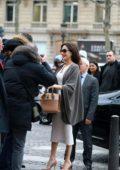 Angelina Jolie greet her fans as she visits Guerlain perfumes shop on the Champs-Elysées in Paris, France