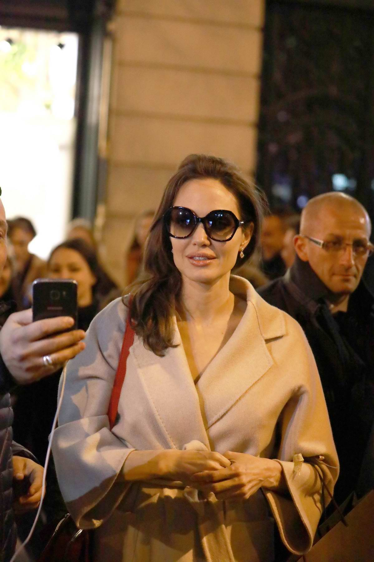 Angelina Jolie makes an appearance at Guerlain Perfumes shop on the Champs-Elysées in Paris, France