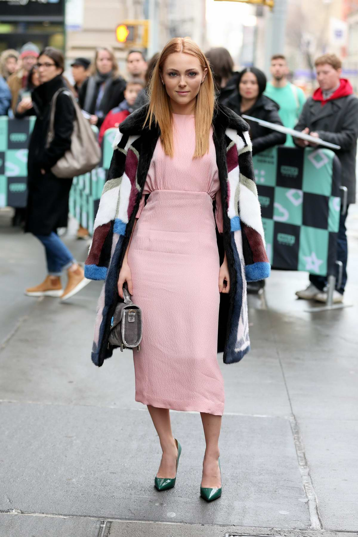 AnnaSophia Robb looks pretty in pink as she visits AOL Build Series in New York City