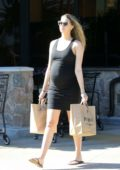 April Love Geary steps out for some grocery shopping wearing a black tank dress in Malibu, California
