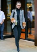 Bella Hadid grabs a coffee while out wearing a Fendi Houndstooth coat in New York City