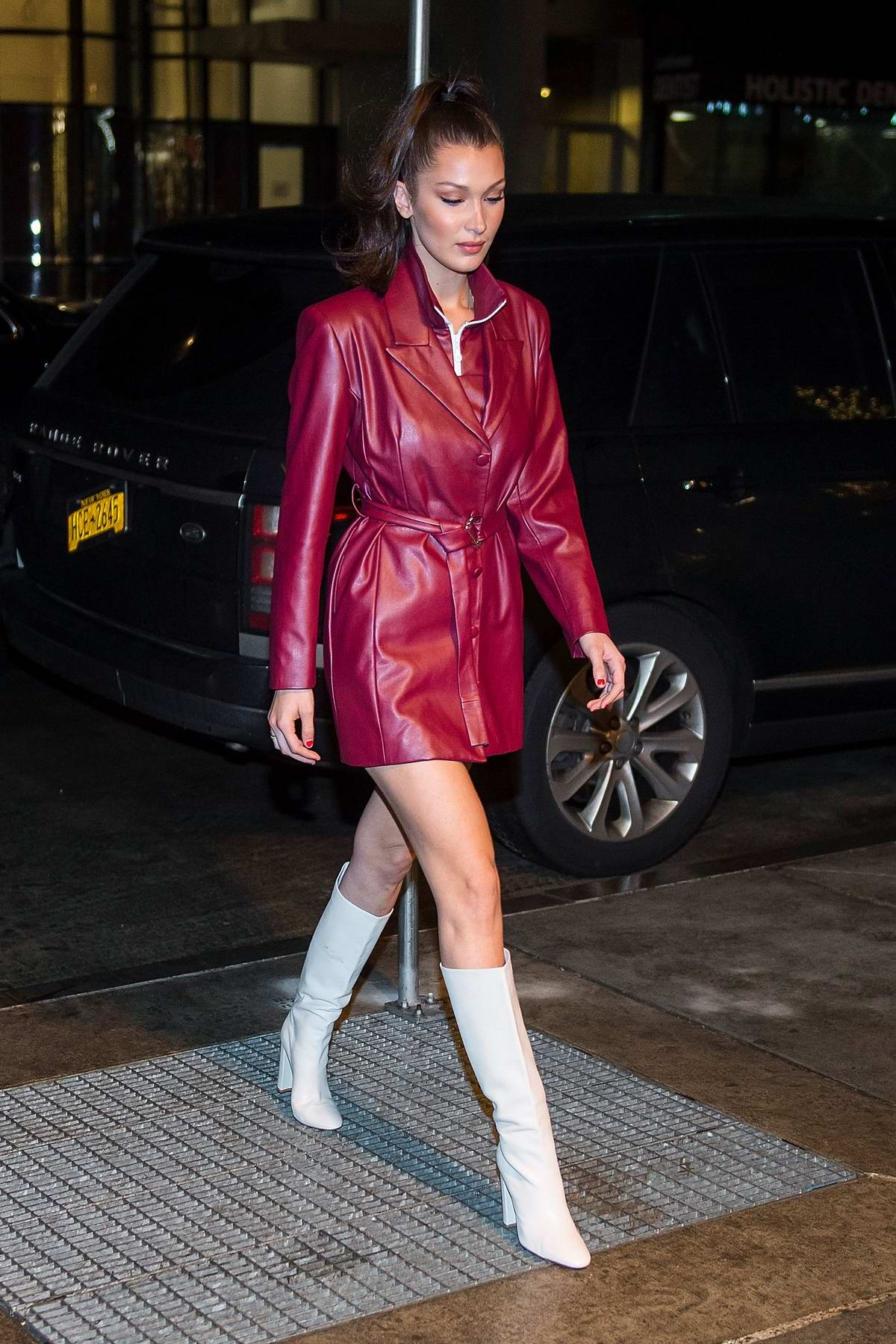 Bella Hadid Rocks A Burgundy Trench Coat Paired With White