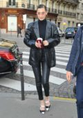 Bella Hadid rocks an all black leather ensemble as she arrives at the Bulgari Store in Paris, France