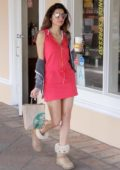 Blanca Blanco in a mini red dress grabs a coffee at Starbucks in Malibu, California
