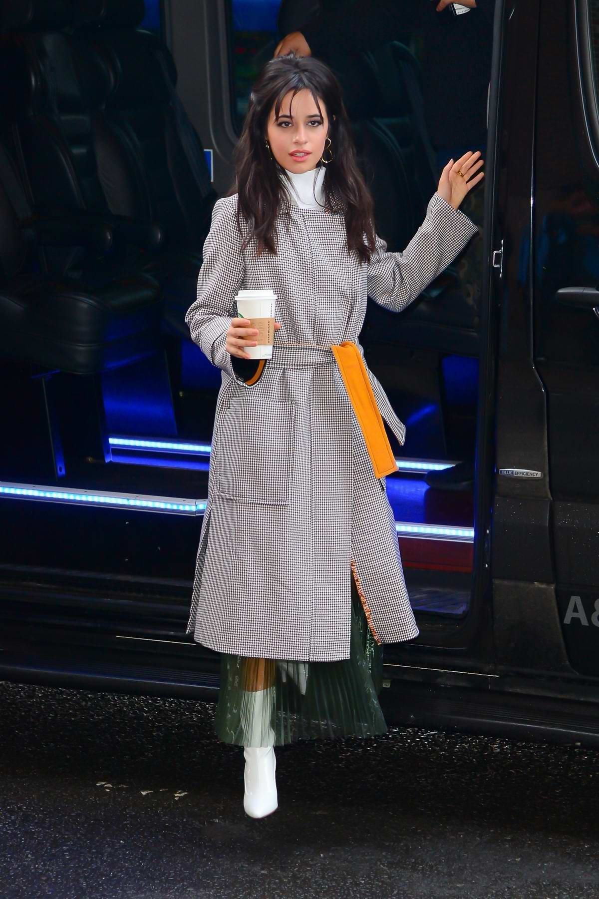 Camila Cabello looking chic and stylish in a long grey coat as she headed out in New York City