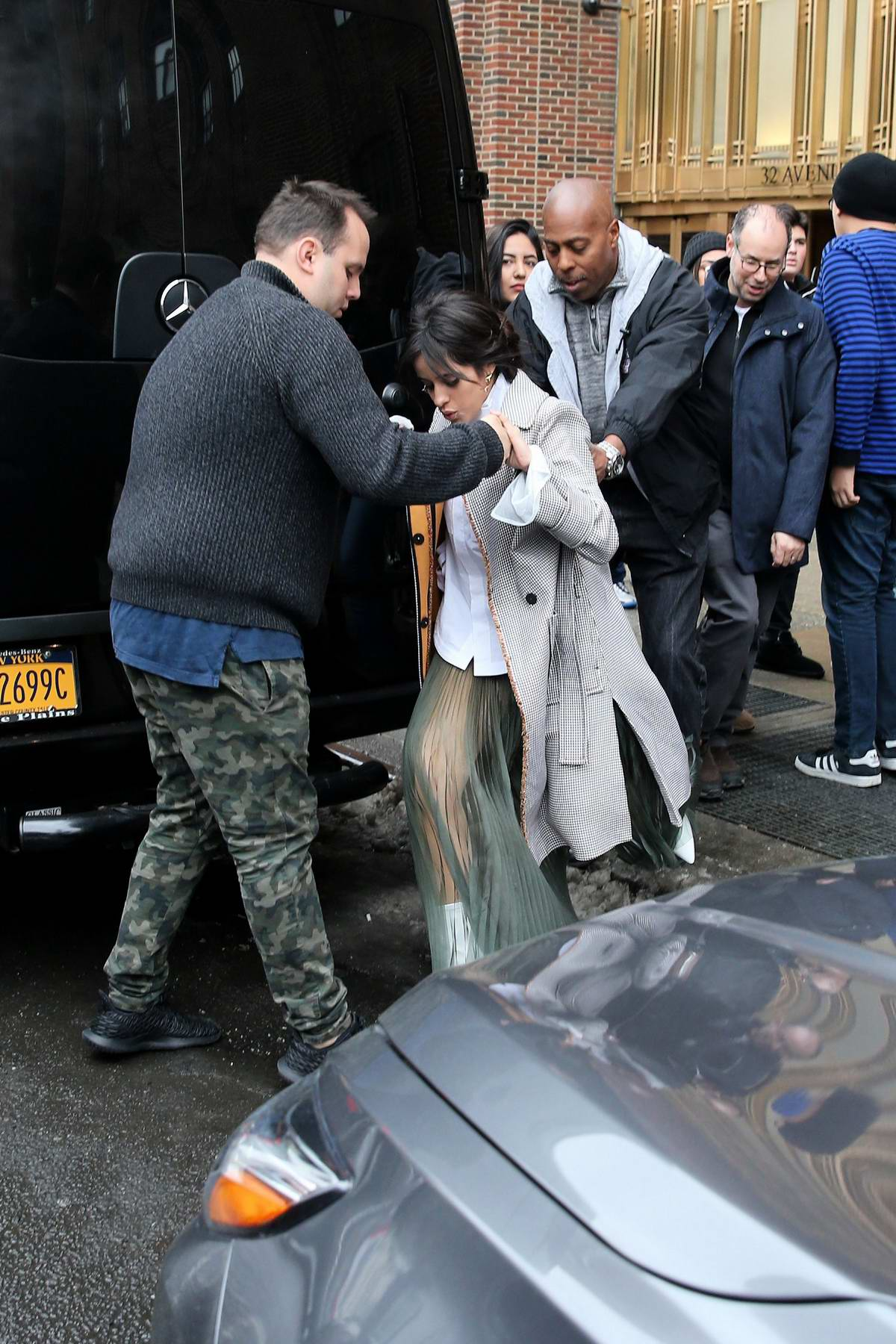 Camila Cabello slips on a snow pile as she leaves 'The Elvis Duran Z100 Morning Show' at Z100 Studio in New York City