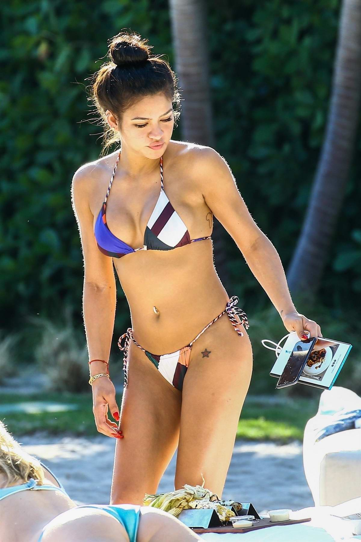 Cassie Ventura wearing a bikini while hanging poolside at her hotel in Miami, Florida