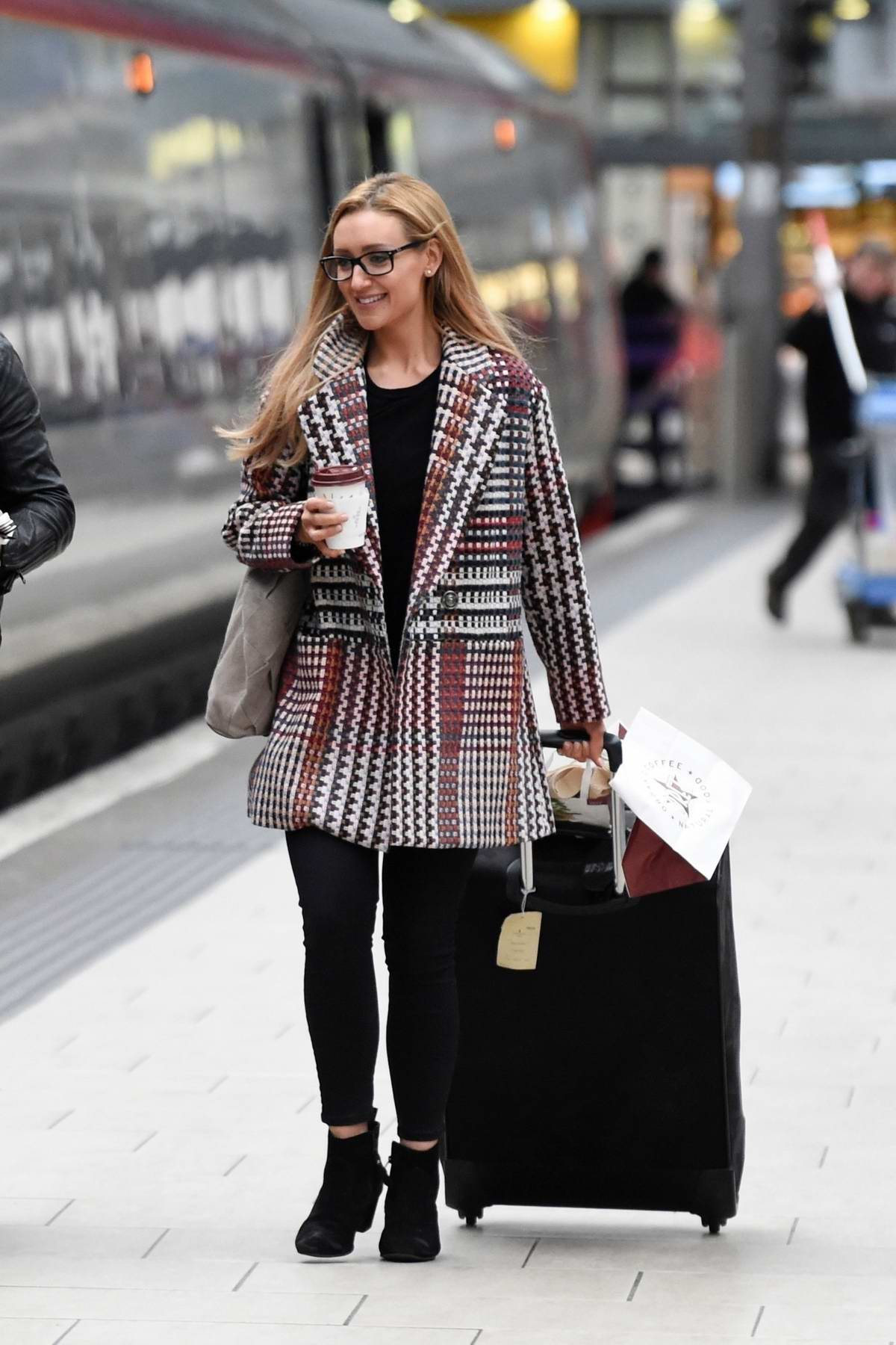 Catherine Tyldesley spotted at the Manchester Piccadilly Station while catching a train to London