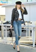 Charlotte McKinney waves to photographers while shopping in Beverly Hills, Los Angeles