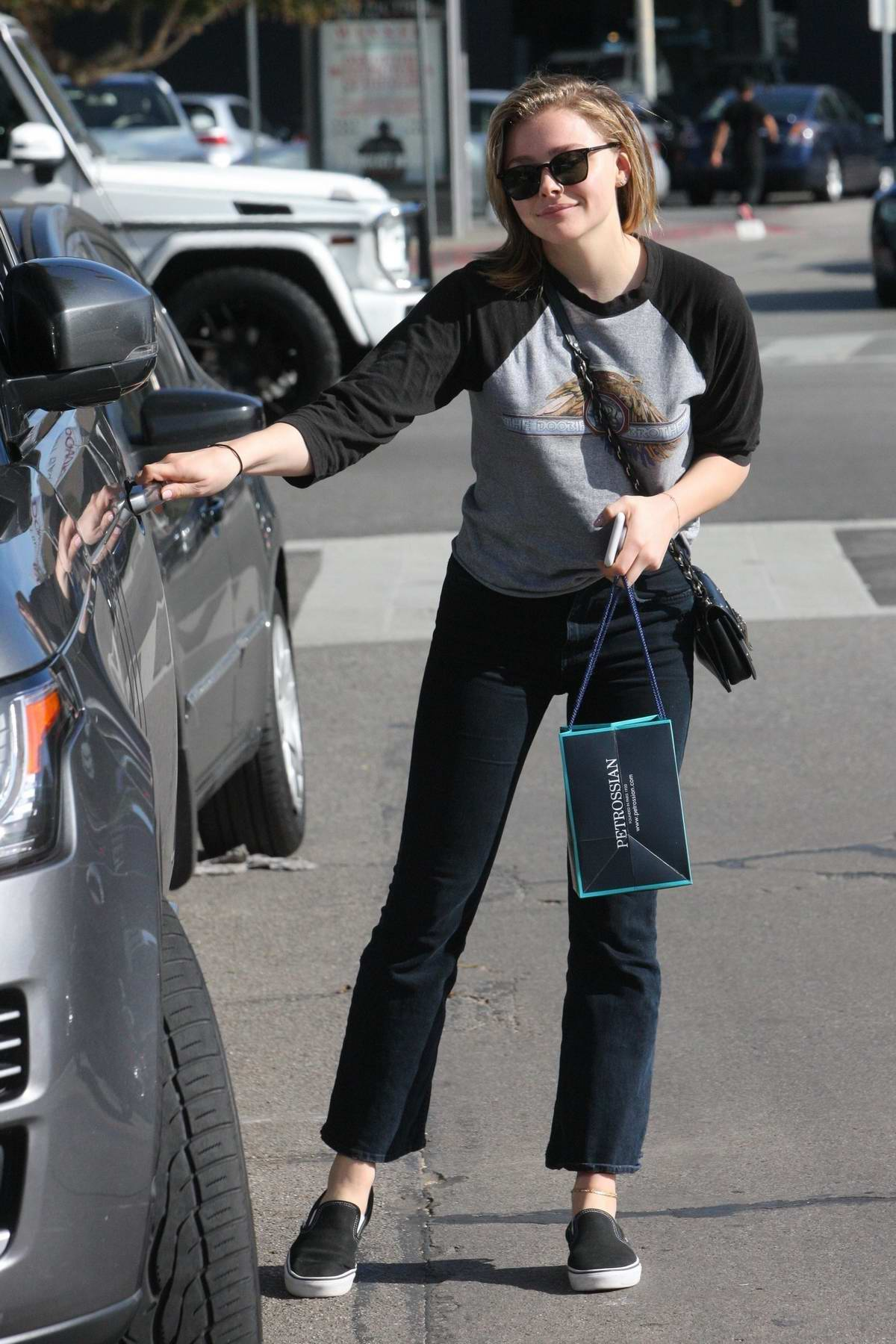 Chloe Grace Moretz grabs caviar to go from french restaurant Petrossian in Beverly Hills, Los Angeles