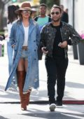 Chrissy Teigen rocks a denim look with thigh high boots as she and John Legend leaves after lunch at Il Pastaio in Beverly Hills, Los Angeles