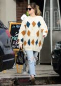 Dakota Johnson dons ripped jeans with a patterned knit sweater while out in Los Angeles