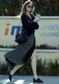 Dakota Johnson starts off her day with a trip to the Earth Bar for a smoothie in West Hollywood, Los Angeles