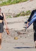 Diane Kruger and Norman Reedus heading out for some surfing in Costa Rica
