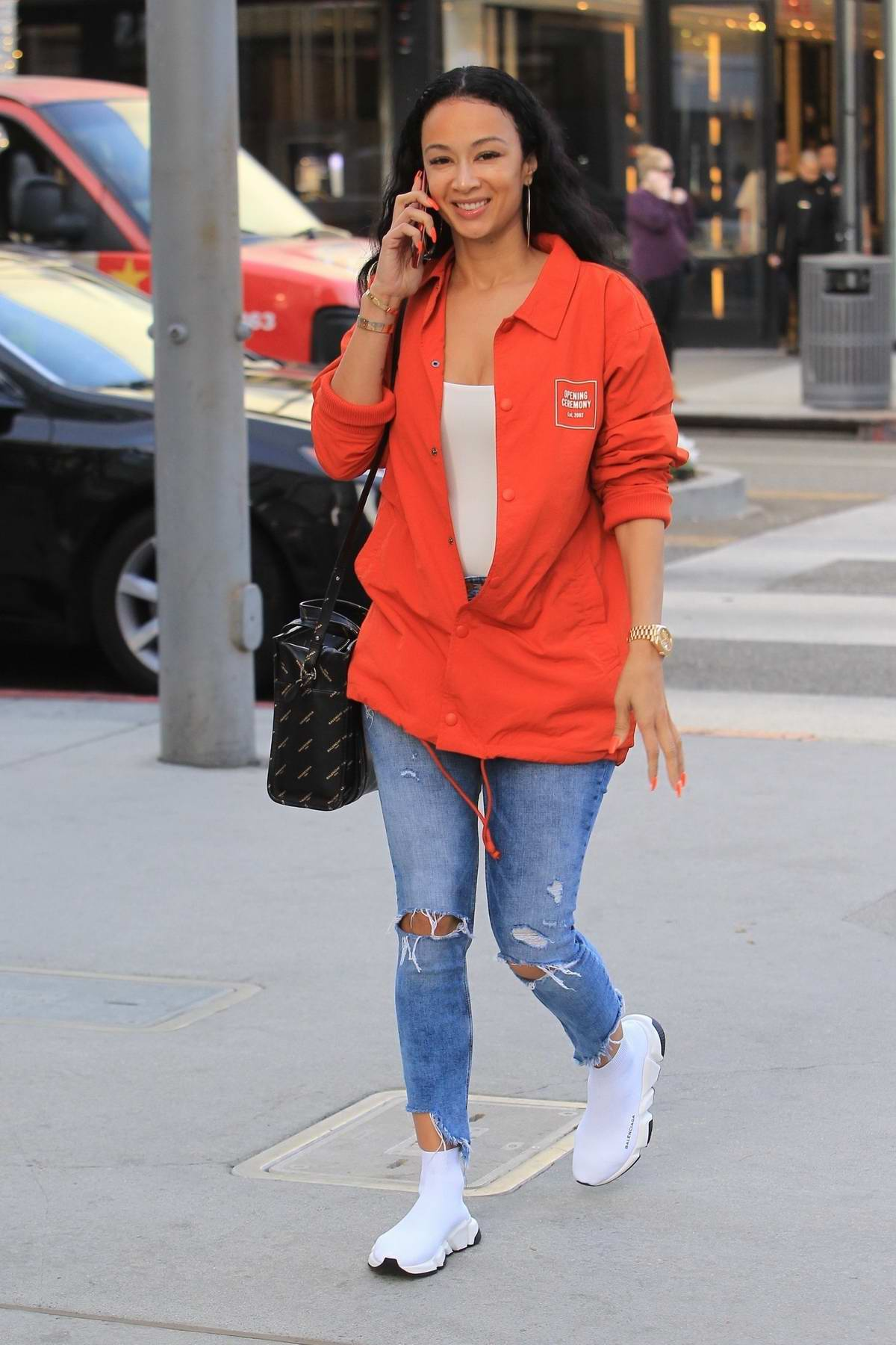 Draya Michele smiles for the cameras while shopping on Rodeo Drive in Beverly Hills, Los Angeles