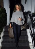 Elizabeth Hurley steps out with her Louis Vuitton as she head to the airport in London