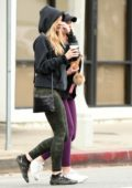 Elizabeth Olsen steps out in a hoodie and camo leggings as she grabs coffee with a friend in Los Angeles