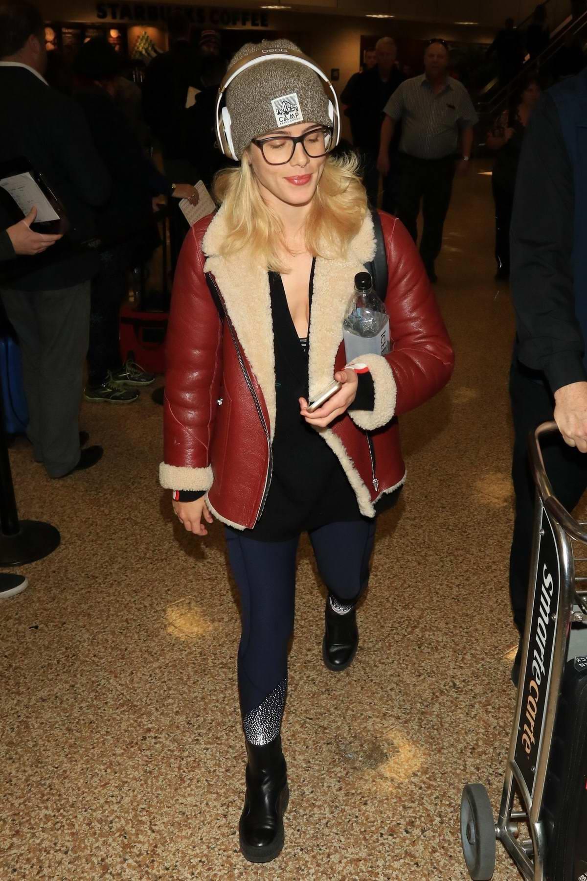 Emily Bett Rickards arrives at the Salt Lake City International Airport in Park City, Utah