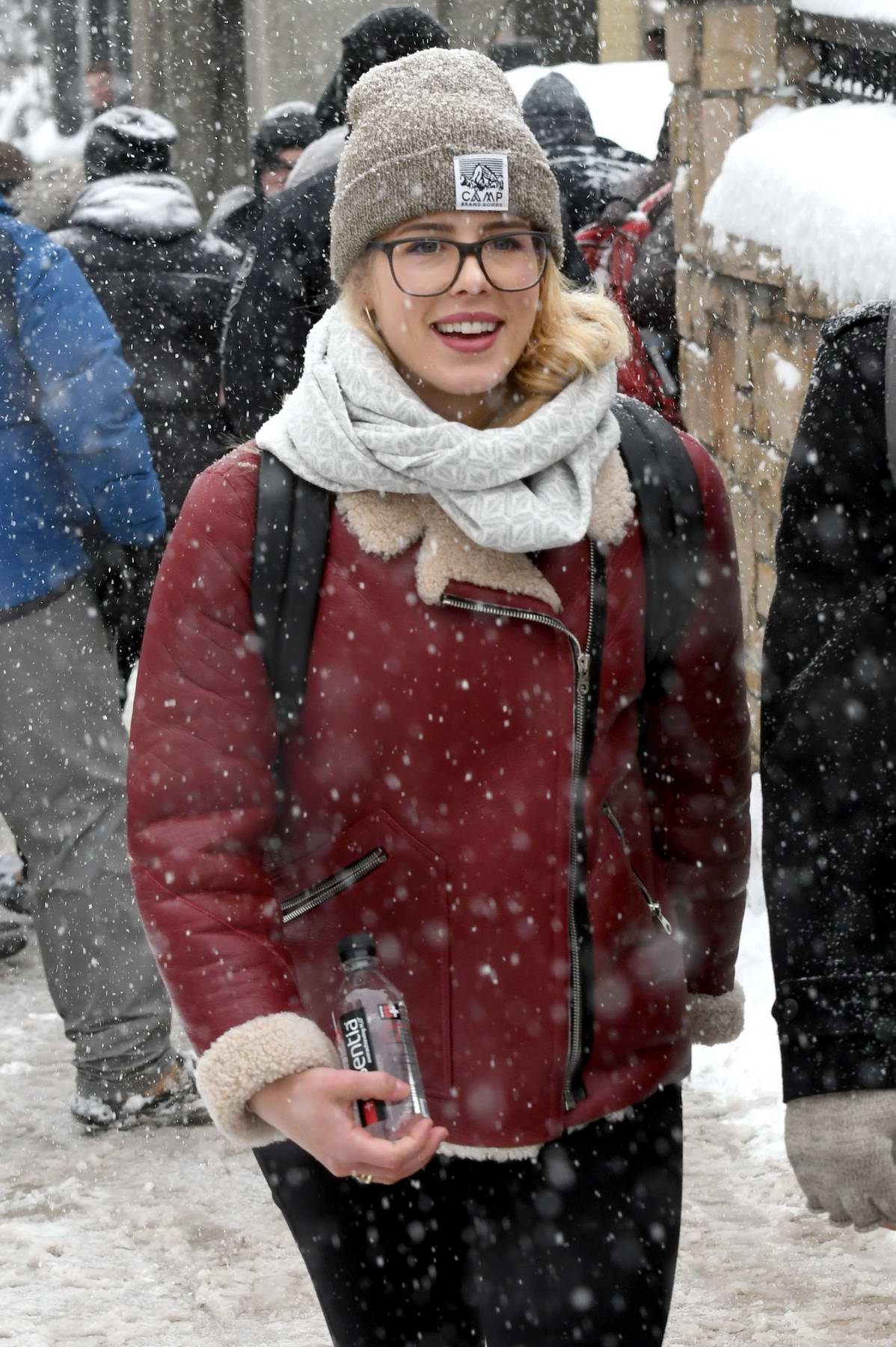 Emily Bett Rickards wore a beanie and fur lined jacket as she stroll around in snow in Park City, Utah